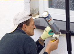 man repairing the house windows